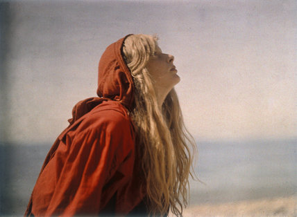 Portrait of Christina wearing a red cloak c.1913.