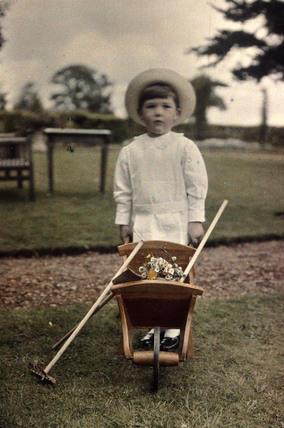Boy with wheelbarrow.
