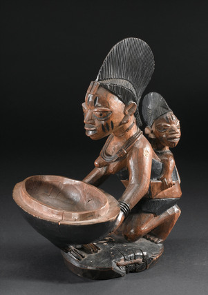 Carved wooden divination bowl, Nigeria, 1880-1920.