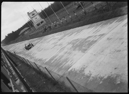 A racing car on the Nurburgring track, Germany, c 1935.
