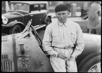 Achille Varzi beside a Bugatti Type 51 racing car, Germany, c 1931.