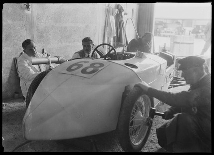 Mechanics with DKW Special racing car, Nurburgring, Germany, 1931.