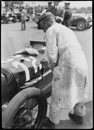 Sign-writer painting the number on an Austin racing car, Berlin, 1933.