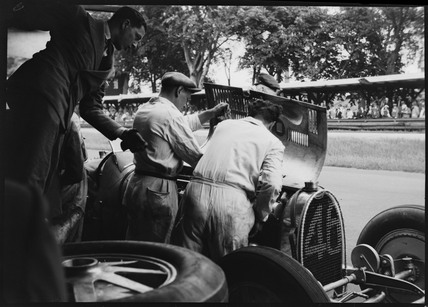 Mechanics working on Albert Divo's Bugatti, AVUS race track, Berlin, 1932.