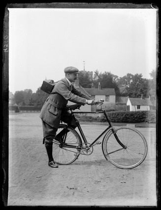 Horace Nicholls setting off on a photographic trip by bicycle, c.1903.