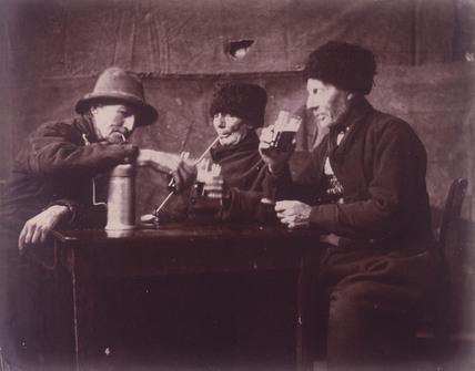 Old men smoking and drinking, Pas de Calais, France, c 1904.
