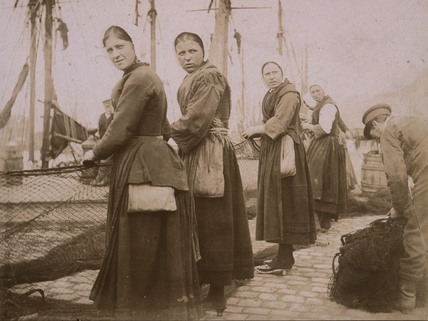 Harbour scene, women holding fishing nets, c 1900-1905.