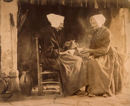 Women having tea, c 1900.