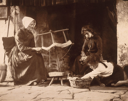 Woman weaving, c 1900.