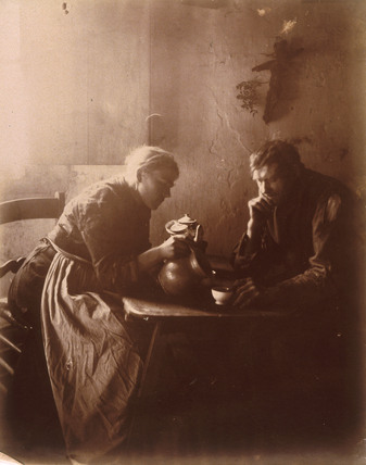 Woman and man drinking tea, c 1900.