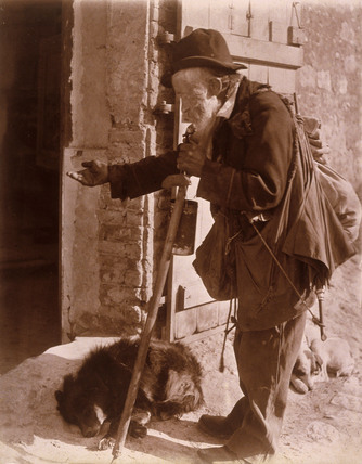 A beggar and his dog, c 1900.