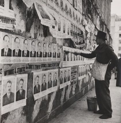 Posters for right wing candidates go up in Greek election campaign, 1946.