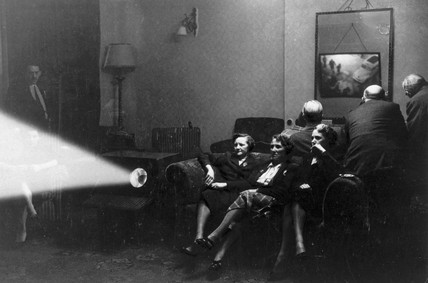 A family watching an early television broadcast, c 1930s.
