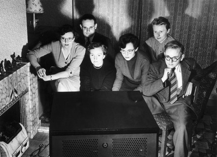 Watching television, 18 March 1954.