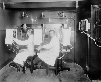 Projection booth with two operators, c 1910.
