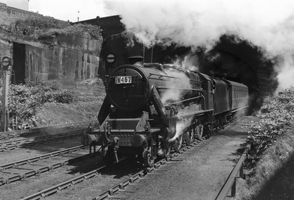 Steam locomotive leaving a tunnel, Cheshire, 1950.