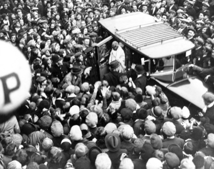 Mahatma Gandhi welcomed by a large crowd, England, 23 September 1931.