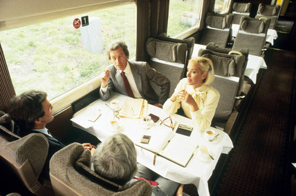Business people travelling by train, c 1980s.