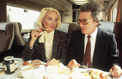 Business people having breakfast on a train, c 1980s.