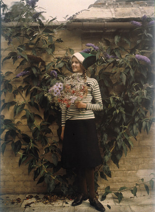 Girl with a bunch of flowers, c 1913.