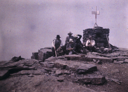 Climbers on hilltop, c 1920.