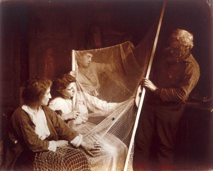 Mending nets, c 1910.