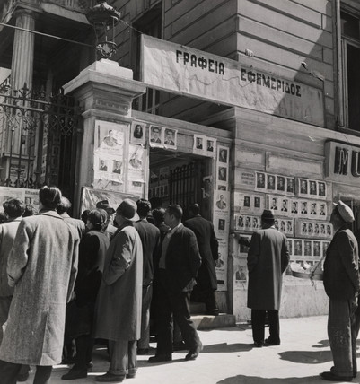 People pause to study campaign posters on eve of election in Greece, 1946.
