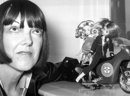 Mary Quant with dolls wearing her outfits, January 1974.