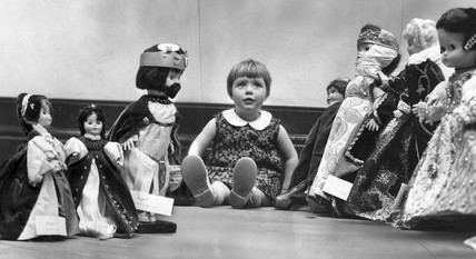 Child with dolls in period costume, Blackpool, May 1966.