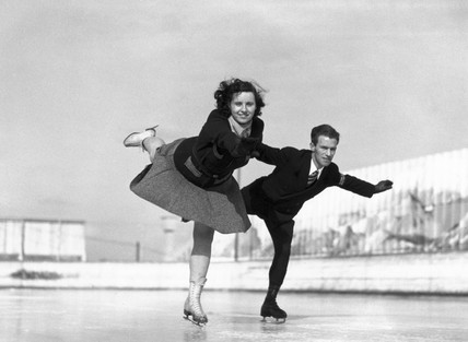 Couple skating on an open-air rink, 1930s