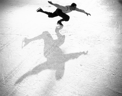 Ice-skater casting a shadow, c 1930s.