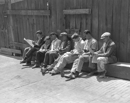 Construction workers relaxing, London, 16 June 1932.