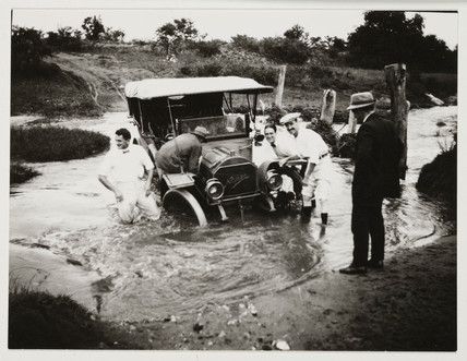 Car stuck in a ford, c 1910.