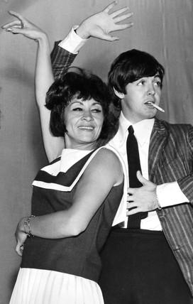 Paul McCartney and Chita Rivera, July 1964.