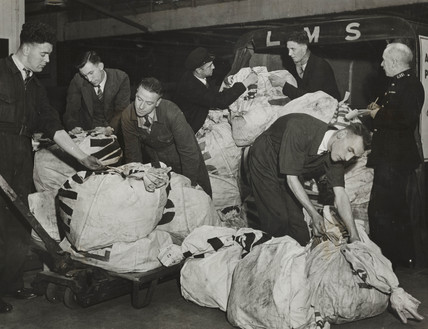 Mail bags are received at the Unity Pools headquarters, 28 January 1946.