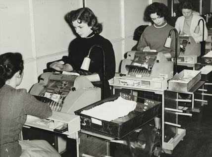 Registering postal orders at Vernons Pools, 2 July 1955.