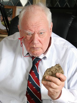 Astronomer Patrick Moore holding a piece of meteorite, 2007.