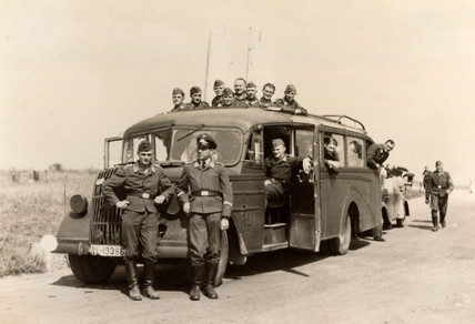 Luftwaffe airmen with bus, Second World War, 1940s.
