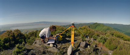 Geologist installing Global Positioning Satellite, New Zealand, 1996.