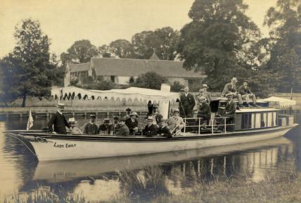 Men on a river boat, 1901-1910.