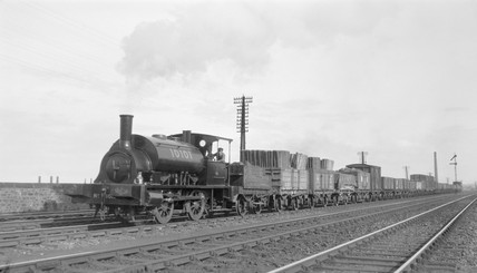 NBR steam locomotive hauling freight, c 1900s.