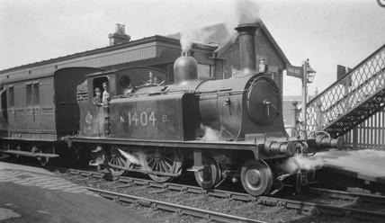 NBR steam locomotive and passenger train, c 1900s.