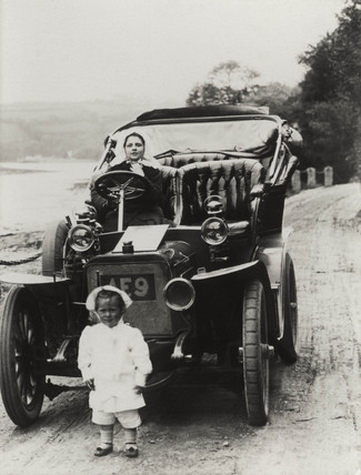 Two children with a car, c 1900s.