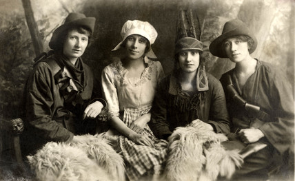 Four young women in fancy dress, 1920s.