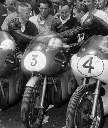 Winners of the TT Seniors motorcycle race, Isle of Man, 17 June 1960.