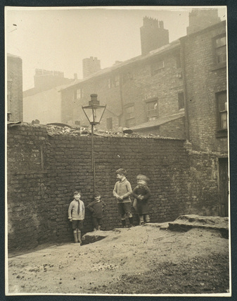 Boys playing in a Manchester slum housing area, c 1935.
