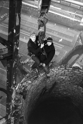 Steeplejacks on top of a chimney, March 1973.