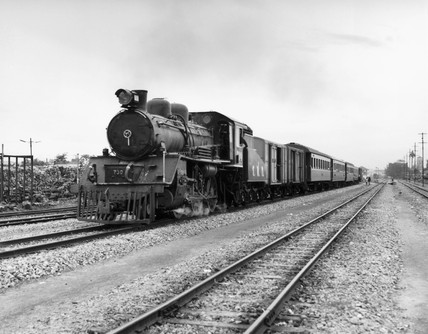 Steam locomotive leaving Thon Buri, Bangkok, Thailand, 1970.