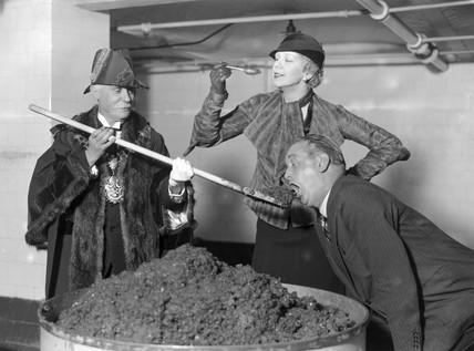 Making the first Christmas pudding at Cadby Hall, London, November 1932.