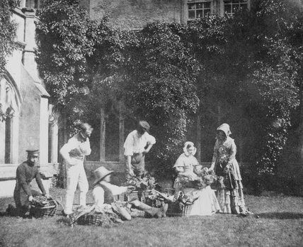 Group outside Lacock Abbey, Wiltshire, c 1840s.